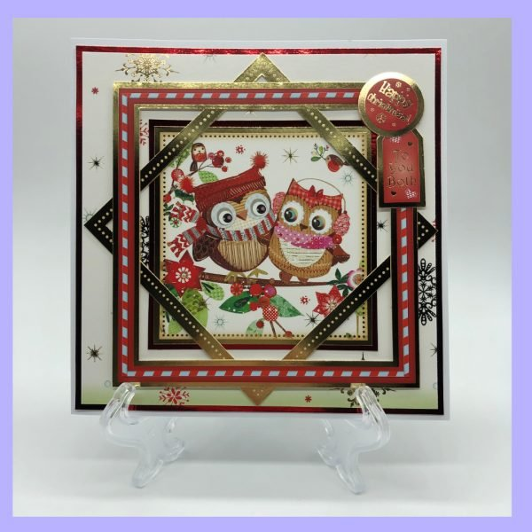 A handcrafted Christmas card with the sentiments Happy Christmas and To you both featuring a pair of owls.